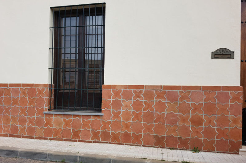 Rustic decorative tiles on façade