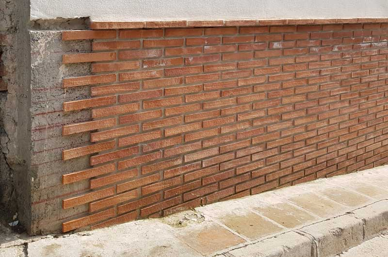 Rustic brick slips in façade